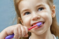 Teeth brushing a little girl Stock Photo