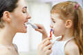 Teeth brushing mother and daughter brush my Royalty Free Stock Photos