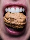 Teeth cracking a nut