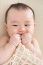 Teething Asian Baby Girl