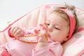 Teething baby girl Royalty Free Stock Photo