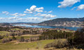 Tegernsee with blue sky white clouds panoramic picture of the lake in bavaria germany Stock Photography
