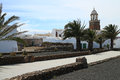 Teguise street scene spanish lanzarote island with the church of in the background Stock Photo