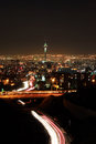 Tehran skyline illuminated at night with motion blur of cars Royalty Free Stock Photo