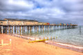Teignmouth pier and beach devon england uk clouds Stock Photo