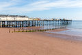Teignmouth pier devon blue sky and white clouds beach england uk with beautiful Royalty Free Stock Image