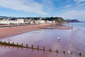 Teignmouth town and beach devon england with holidaymakers enjoying the sunny warm weather Royalty Free Stock Photo