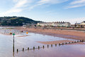 Teignmouth town and beach devon england with holidaymakers enjoying the sunny warm weather Royalty Free Stock Image