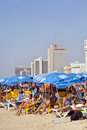 Tel aviv israel august th view looking north tel aviv beach hotels strip clear day packed thousands people either sunbathing Royalty Free Stock Images