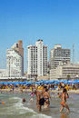 Tel aviv israel augutst th view looking north at the tel aviv beach and hotels strip on a clear day packed with thousands of Royalty Free Stock Image