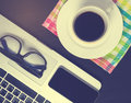 image photo : Black Smart phone screen on office coffee desk