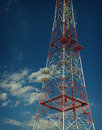 Tele radio tower coseup red and white against a background of the blue sky Royalty Free Stock Photo