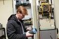 Telecom engineer adjusting reflectometer Royalty Free Stock Photo