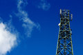 Telecom tower stand over the cloud and blue sky Royalty Free Stock Image