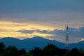 Telecom tower stand over the mountain at sunset Royalty Free Stock Photo