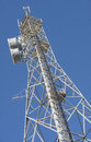 Telecommuncation tower against blue sky a tall metal telecommunication set a deep Royalty Free Stock Image