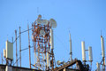 Telecommunication base stations network repeaters on the roof of the building. The cellular communication aerial on a building roo Royalty Free Stock Photo