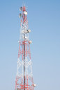 Telecommunication mast with microwave link antennas over a blue sky Royalty Free Stock Photography