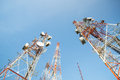 Telecommunication mast tv antennas with blue sky in the morning Stock Image