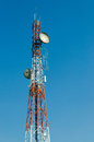 Telecommunication radio antenna and satelite tower with blue sky Stock Image