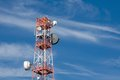 Telecommunication radion antenna satelite tower blue sky Royalty Free Stock Photography
