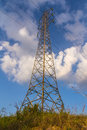 Telecommunication tower with antennas against blue sky background Royalty Free Stock Photo