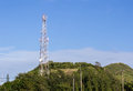 Telecommunication tower with antennas on mountain Royalty Free Stock Images
