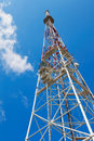 Telecommunication tower on blue sky Stock Photos