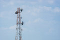 Telecommunication tower with blue sky background. Royalty Free Stock Photo