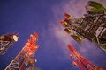 Telecommunication tower group of towers at night Royalty Free Stock Photography