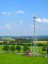 Telecommunication tower in landscape Royalty Free Stock Photography