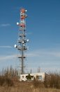 Telecommunication tower radion antenna and satelite with blue sky Royalty Free Stock Photography