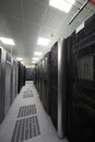 Telecommunications equipment in racks and colored cables the server room Stock Photography
