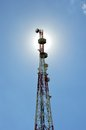 Telecommunications tower against the sunshine Stock Photo