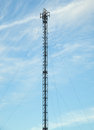 Telecommunications tower with antennas for gsm coverage and g g directional antennas Royalty Free Stock Photography