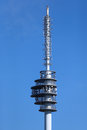 Telecommunications tower with dishes and antennas Royalty Free Stock Image