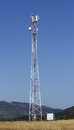 Telecommunications tower with mobile phones antennas Royalty Free Stock Photo