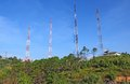 Telecommunications tower on mountain with blue sky Royalty Free Stock Photography