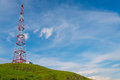 Telecommunications tower over blue sky background Royalty Free Stock Image