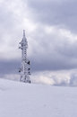 Telecommunications tower on top of a mountain in florina greece in winter Stock Photo