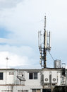 Telecoms antenna on roof top of building Stock Photo