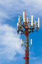 Telecoms cell phone tower mobile telecommunication radio antenna and blue sky Stock Photo