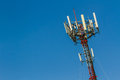 Telecoms cell phone tower mobile telecommunication radio antenna and blue sky Royalty Free Stock Photo