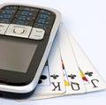 Telefone móvel em 3 cartões de jogo usados Fotografia de Stock Royalty Free