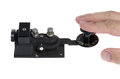 Telegraph key with hand operating it Royalty Free Stock Photo