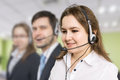 Telemarketing and customer service concept. Young smiling woman in call centre Royalty Free Stock Photo