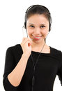 Telemarketing headset woman in black suit from call center smiling happy talking in hands free device beautiful mixed race Royalty Free Stock Photo