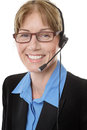 Telemarketing headset woman close up shot of a mature business wearing a isolated on white Stock Image