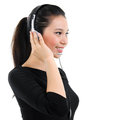 Telemarketing headset woman portrait in black suit from call center smiling happy talking in hands free device attractive mixed Royalty Free Stock Photo
