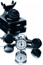 Telephone black bakelite and alarmclock Royalty Free Stock Photo